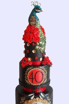 Bespoke 40th birthday cake incorporating a peacock and magpies, for an event in Manchester