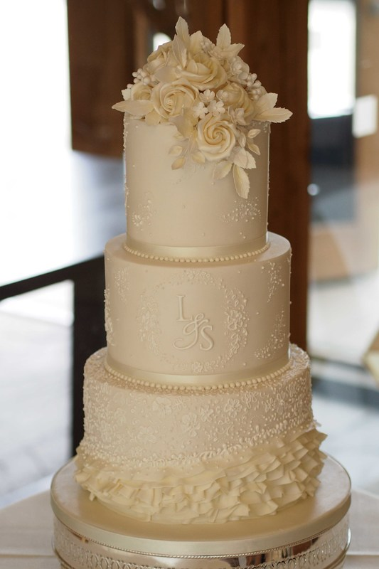 Ivory Wedding Cake With Lace Design And Monogram The Frostery