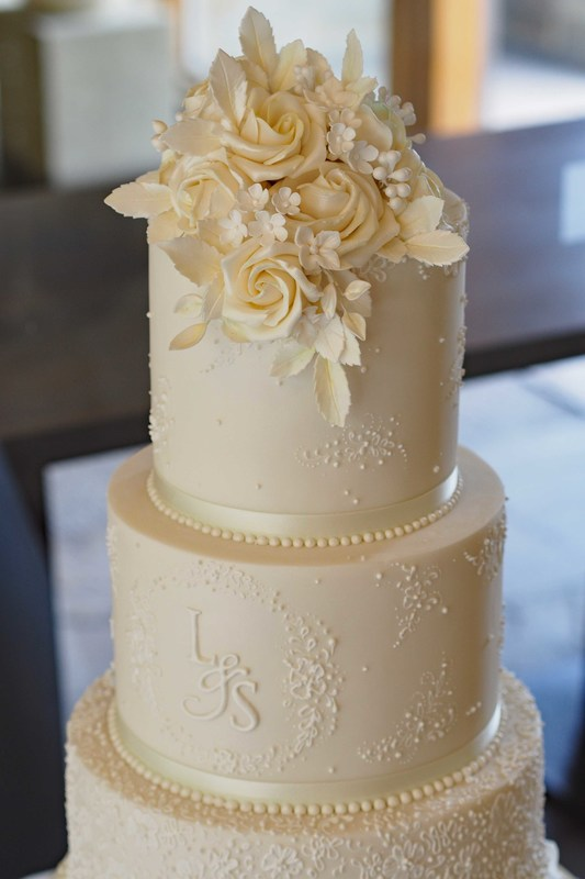 Ivory Wedding Cake With Lace Design And Monogram The